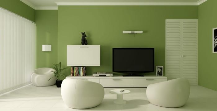 kleines wohnzimmer einrichten wandfarbe grün weiße runde sessel wandregale