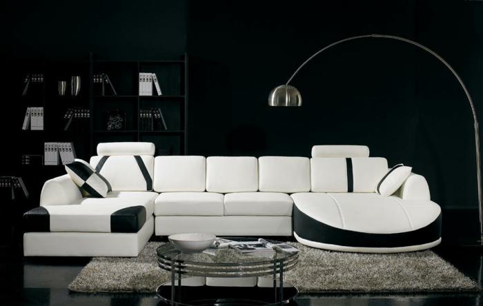 schwarze wandfarbe weiße möbel wohnzimmer runder glastisch bogenlampe
