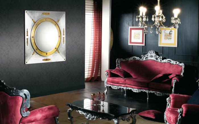 schwarze wandfarbe wohnzimmer einrichten luxuriöse rote sofas eleganter couchtisch