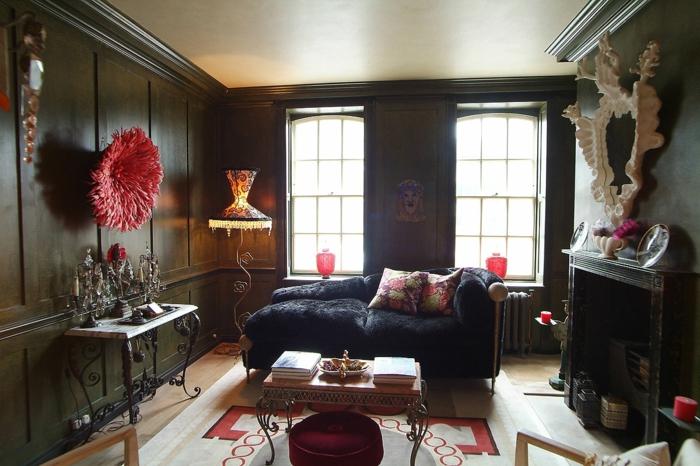 schwarze wandfarbe wohnzimmer gestalten farbiger teppich wanddeko rote akzente
