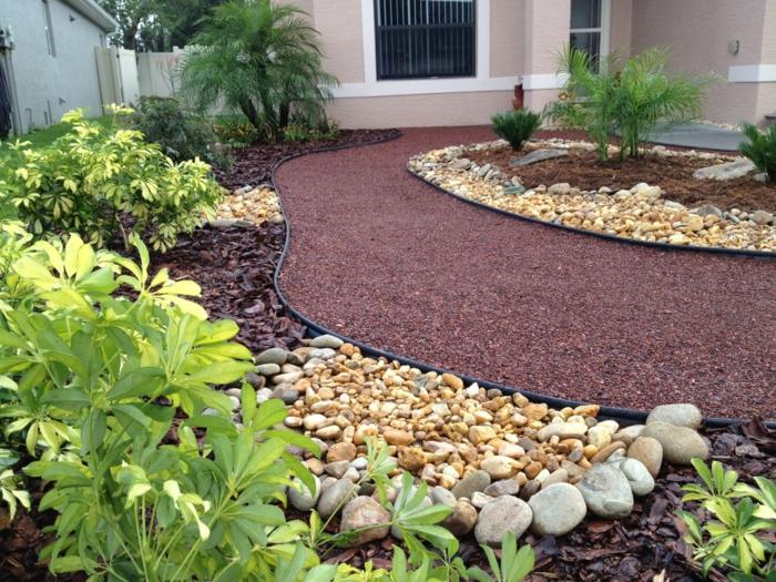 vorgarten gestalten gartensteine kieselsteine bewässerung gartenpflanzen