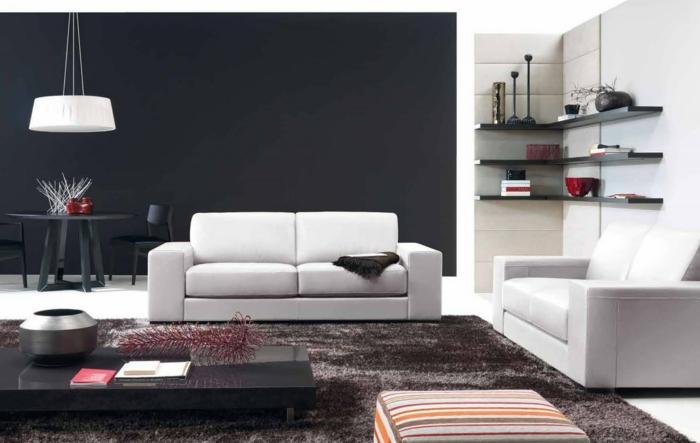 wandgestaltung ideen wohnzimmer scvhwarze akzentwand essecke weiße sofas eckregale