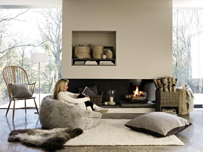 zimmer einrichten ideen gemütliches wohnzimmer gestalten feuer bodenkissen fell