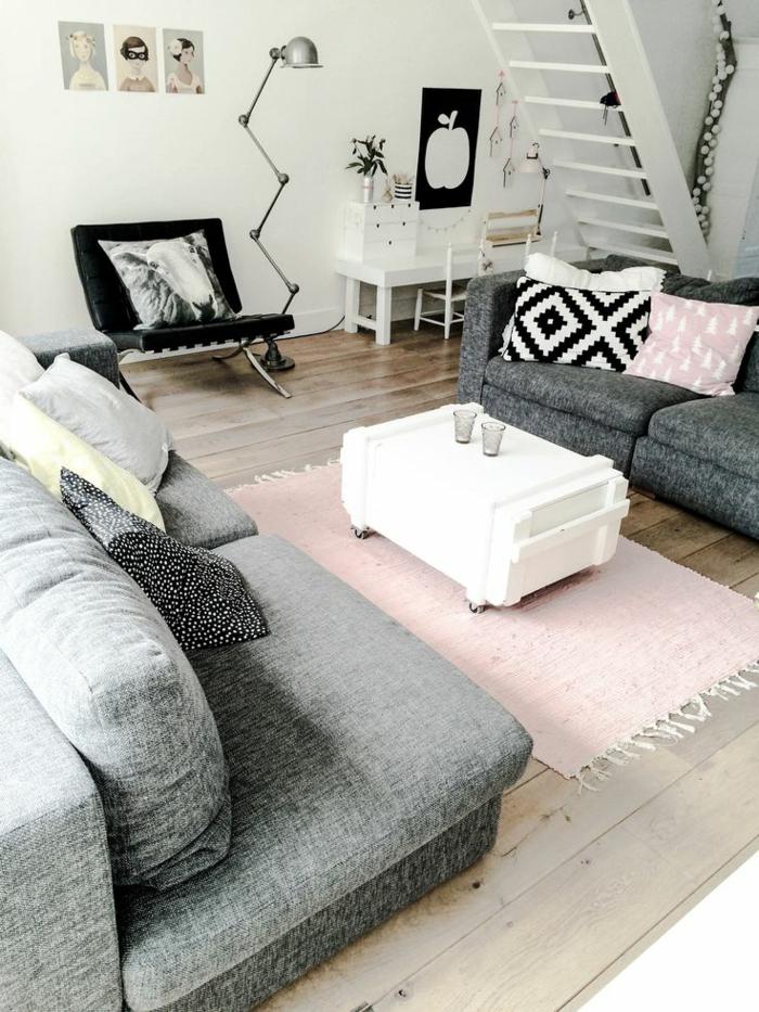 zimmer-einrichten-ideen-wohnzimmer-hellrosa-teppich-weißer-couchtisch