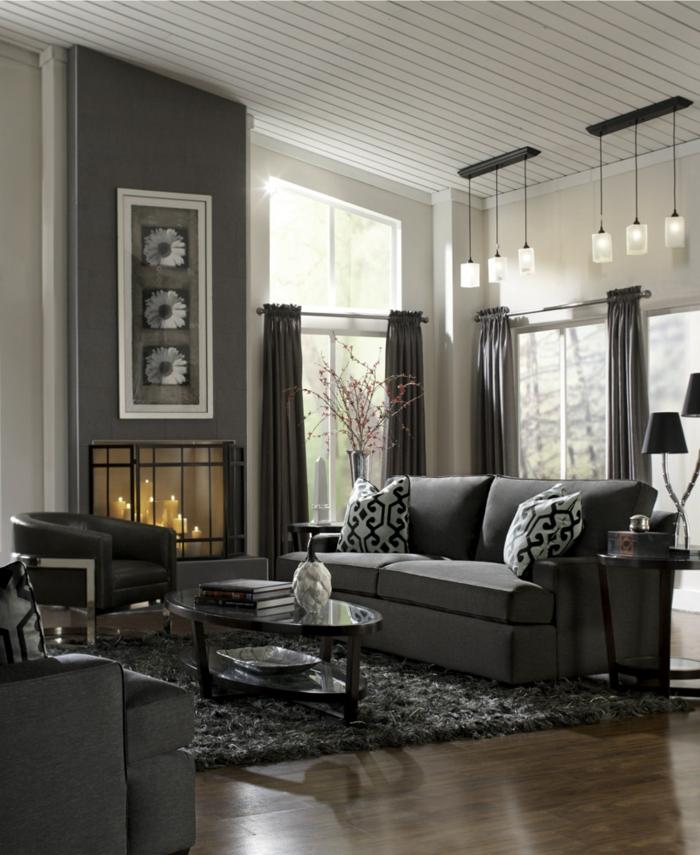 zimmereinrichtung-wohnzimmer-graue-möbel-teppich-kamin-hängeleuchten