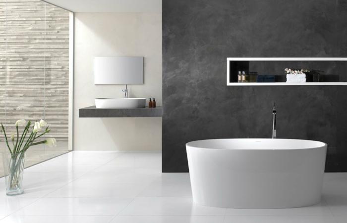 badeinrichtung ovale badewanne graue akzentwand blumen weiße bodenfliesen