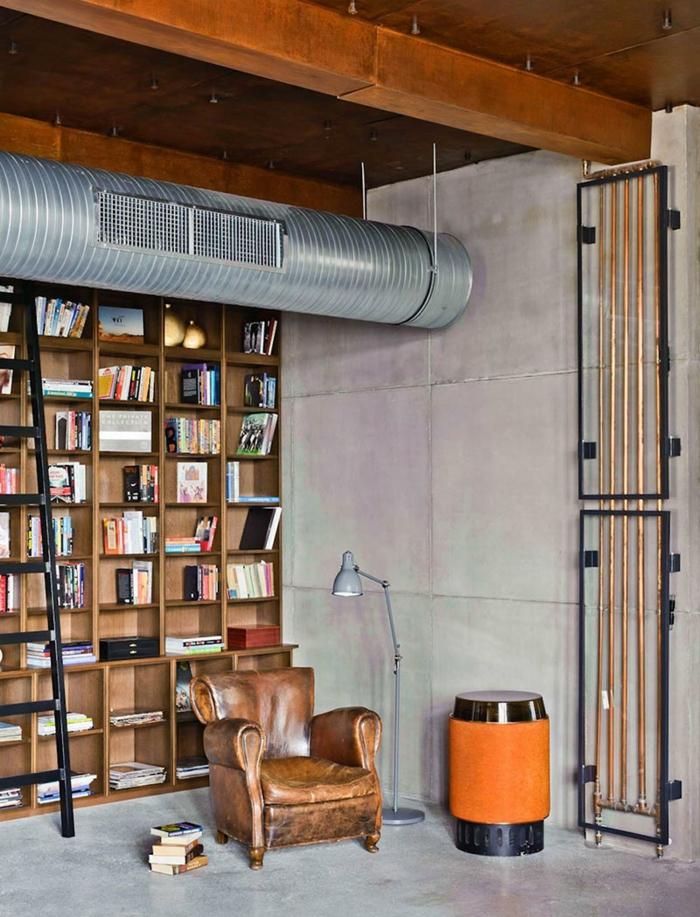 einrichtungsideen wohnen röhre blech industrieller stil bibliothek ledersessel