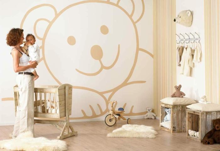 kinderzimme einrichten babybett holz fächer hocker diy ideen holzkisten sperrholz wanddekoration bärchen