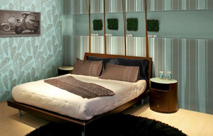 schlafzimmer idee blaugrüne wandtapeten blätter muster streifen