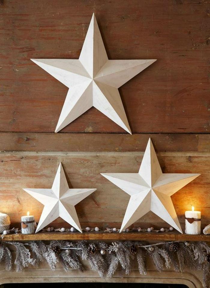 weihnachtsdekoration ideen puristisch kaminsims weiße sterne girlande tannenzweige