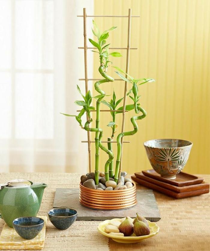 bambus deko bambusstangen ideen wohnaccessoires tischdeko kieselsteine tee trinken