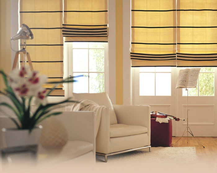 gardinenstoffe vorhangstoffe vorhänge pastell gelb modernes design wohnzimmer ledersessel