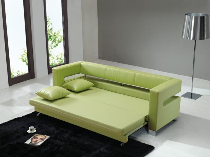 schlafsofa design grün stilvoll wohnzimmer schwarzer teppich