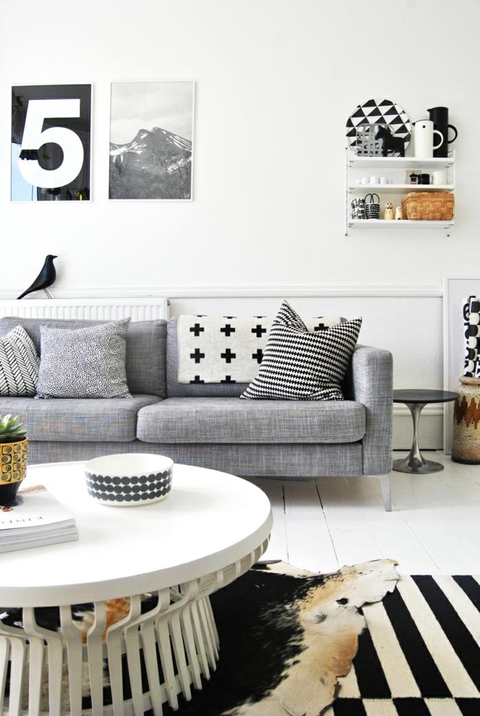 wandfarbe weiß wohnzimmer graues sofa runder couchtisch