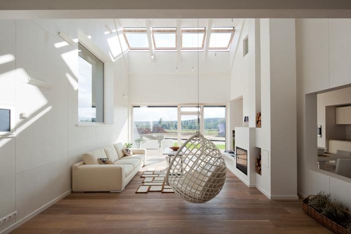 weiße wandfarbe wohnzimmer hängesesseel panoramafenster ausgefallener teppich