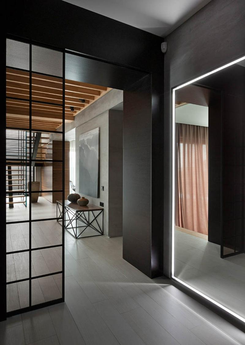 Shore House NOTT Design Studio Wohnung einrichten Betonoptik Wandspiegel