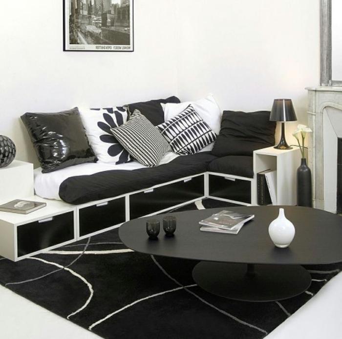 einrichtungsideen wohnzimmer weiß schwarz ausgefallener couchtisch weißer bodenbelag