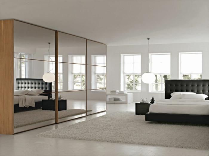 kleiderschrank design schiebetüren schlafzimmer teppich spiegel