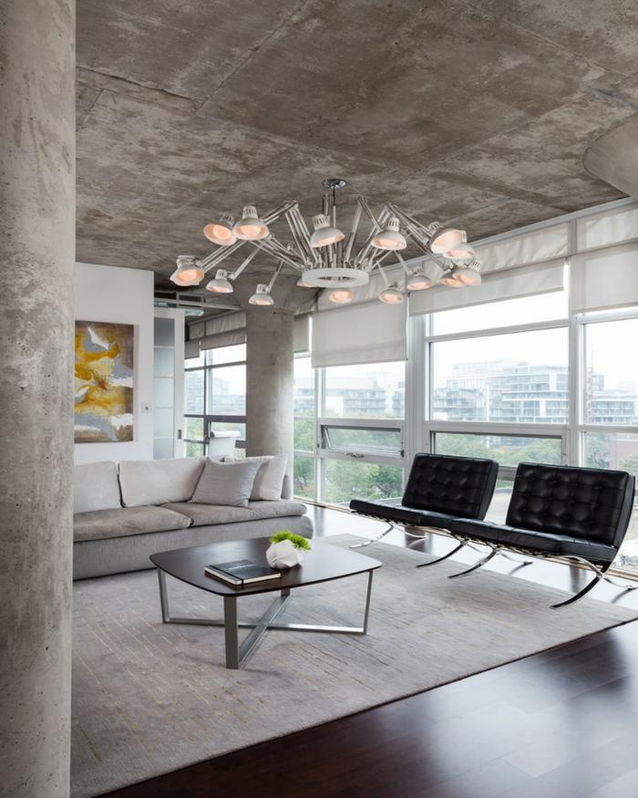 schöne wohnideen wohnzimmer beton wandgestaltung zimmerdecke teppich vintage sessel