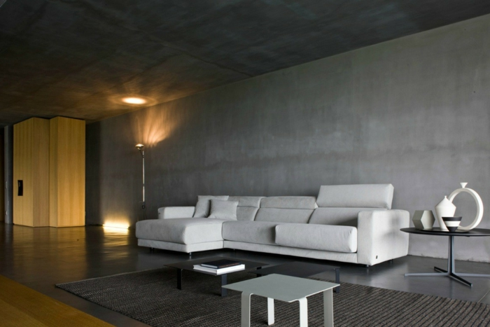 schöne wohnideen wohnzimmer geräumig betonoptik wandgestaltung teppich leuchten