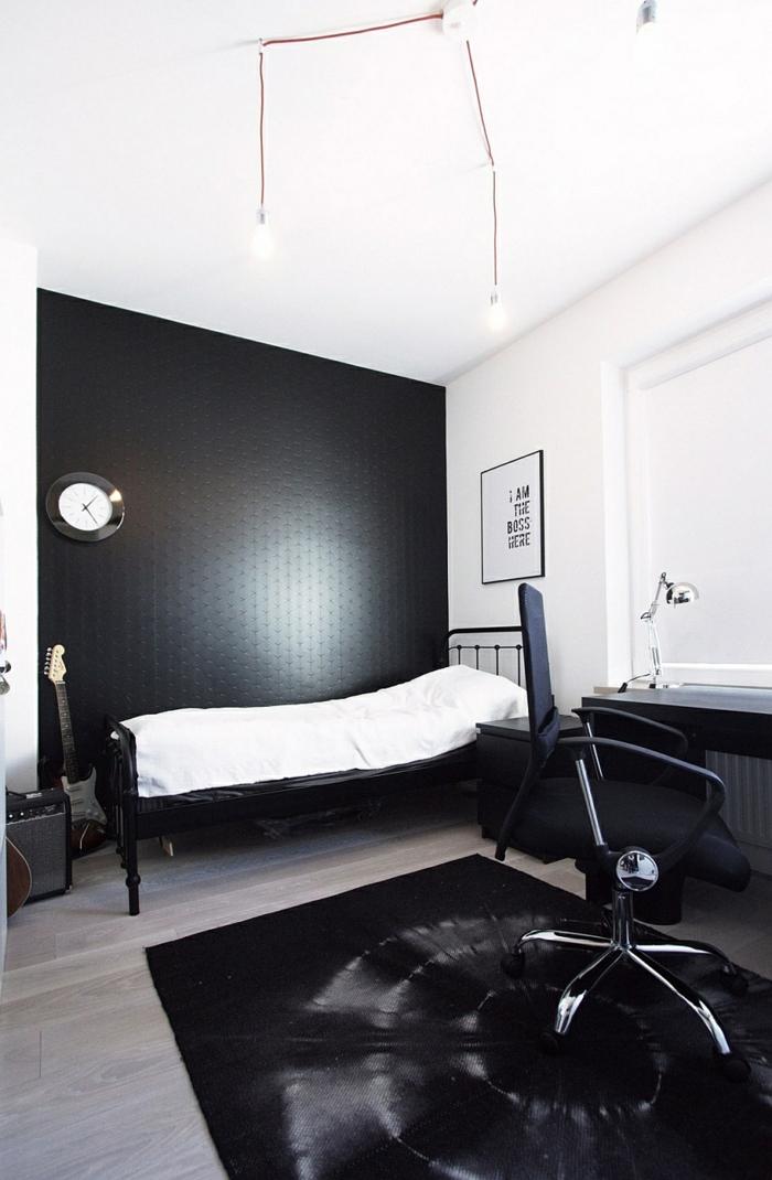 schwarze wandfarbe minimalistisches schlafzimmer akzentwand schwarzer teppich holzboden