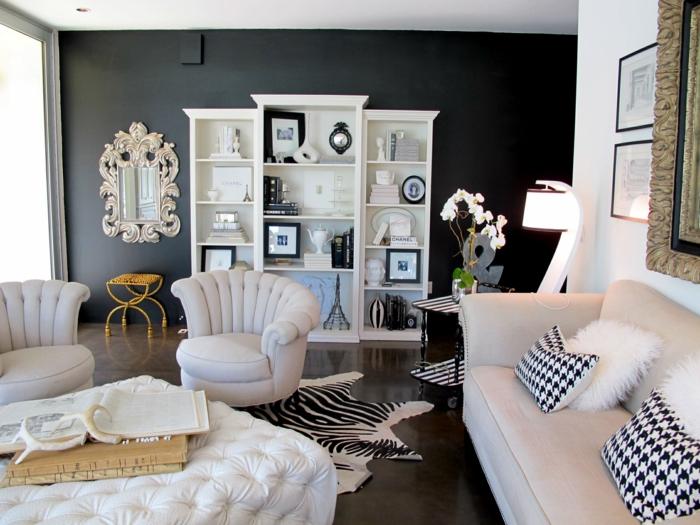 wandfarbe schwarz weiße möbel wohnzimmer schwarze akzentwand fellteppich