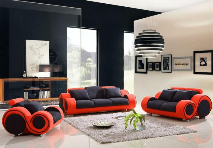 wandfarbe schwarz wohnzimmer einrichten möbel schwarz rot beiger teppich