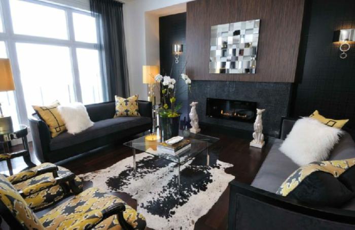 wandfarbe schwarz wohnzimmer schwarze möbel gelbe akzente kamin