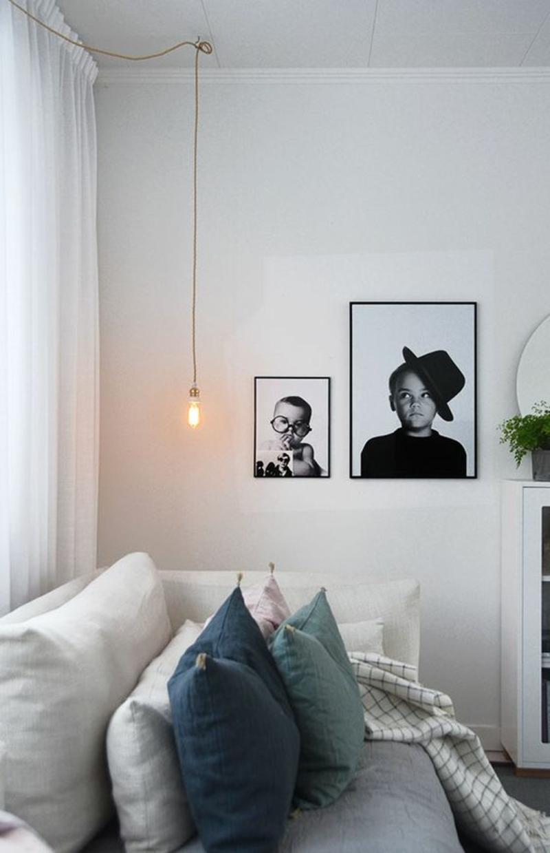 Wohnung skandinavisch einrichten Sofakissen Bilder schwarz weiß