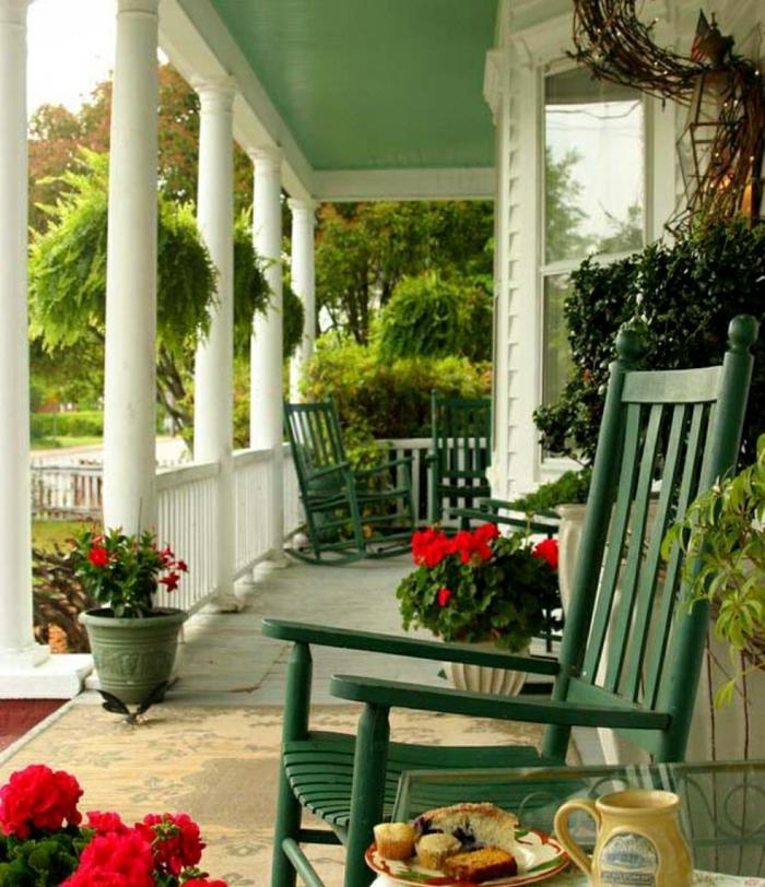 bastelideen frühling veranda dekorieren blumentöpfe schaukelstühle