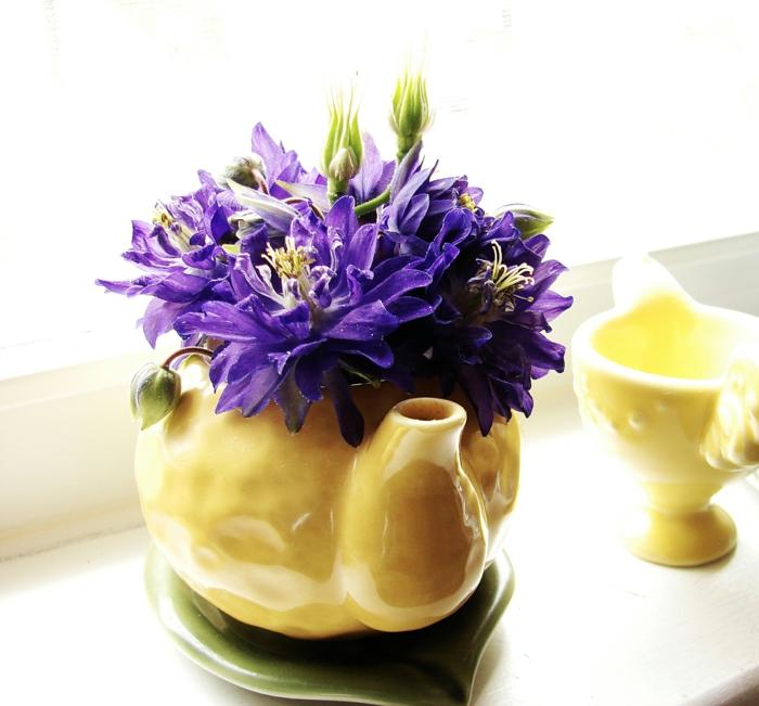 tischdeko grün weiß osterdekoration gelb lila
