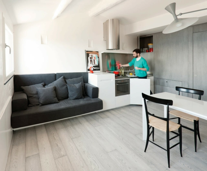 einzimmerwohnung graues sofa esstisch küche raumgestaltung