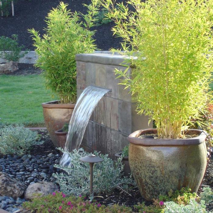gartenbrunnen design ausgefallen riesige pflanzenbehälter