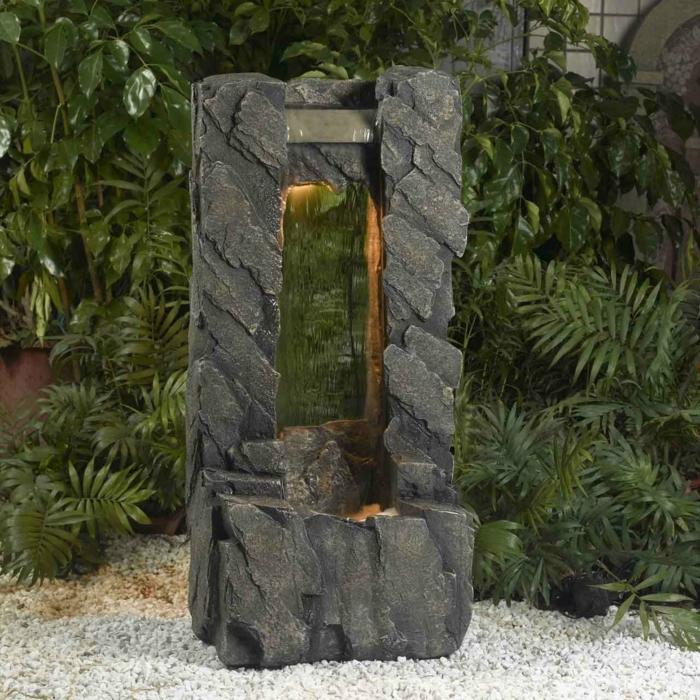 gartenbrunnen design garten wasser kieselsteine pflanzen