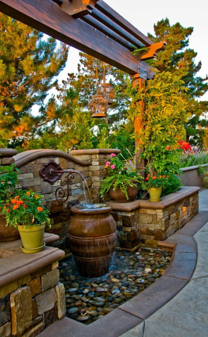 gartenbrunnen gartengestaltung ideen steine pflanzentöpfe