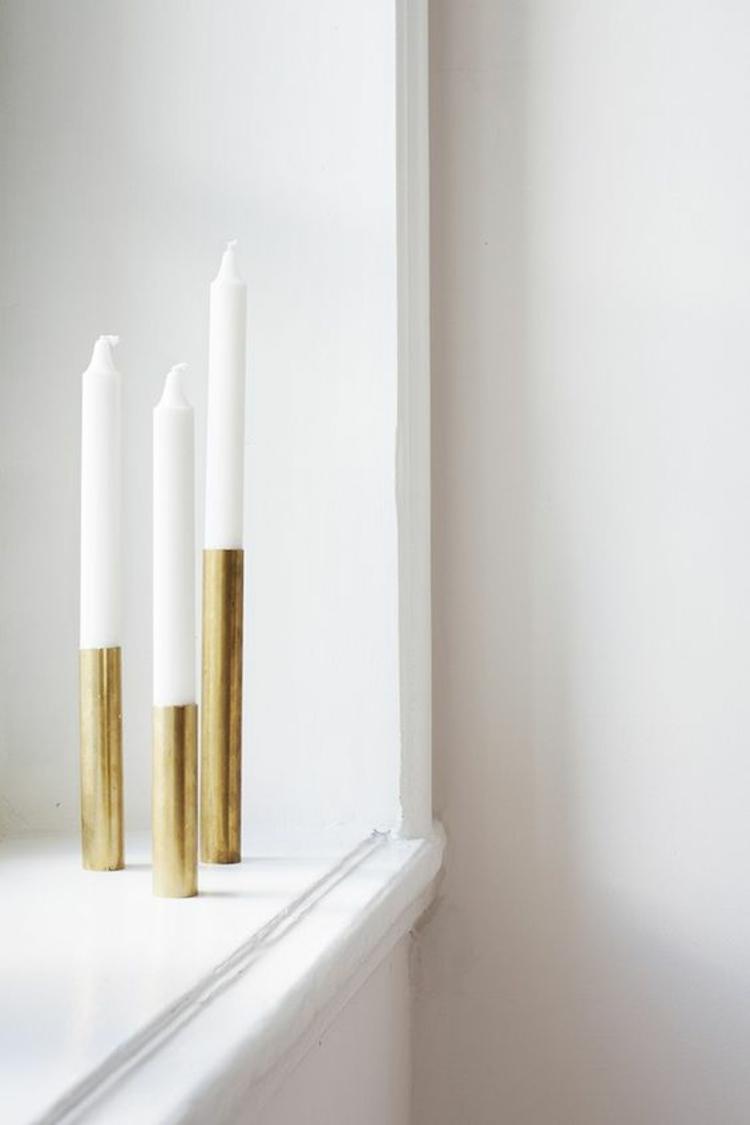 goldfarbene skandinavische Wohnaccessoires minimalistische Kerzenständer