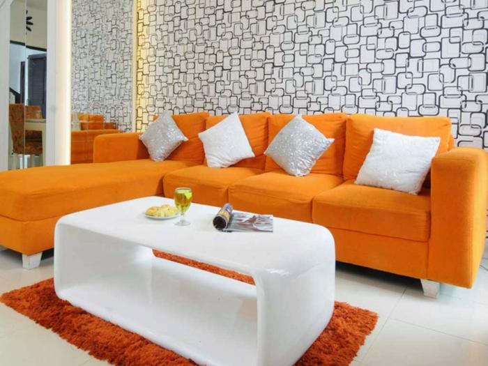 innendesign ideen wohnzimmer gestalten orange möbel weißer couchtisch