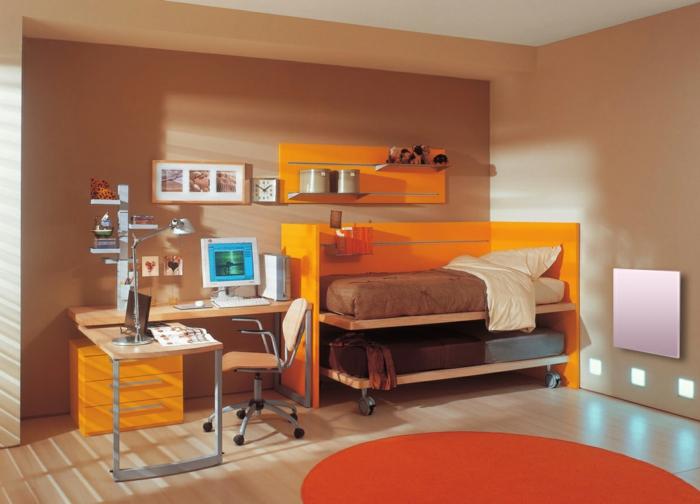 innendesign braune akzentwand runder teppich orange