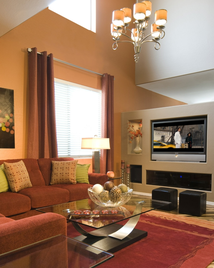 innendesign wohnideen wohnzimmer gemütlich orange wände roter teppich