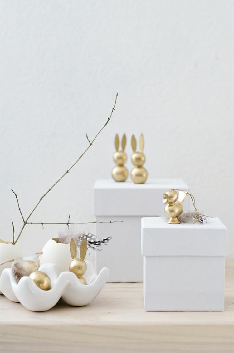 originelle Osterdeko selber machen goldene Osterhasen