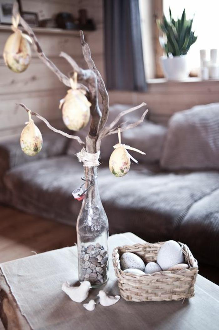 dekoideen ostern zweig dekorieren ostereier flasche vase tischdeko