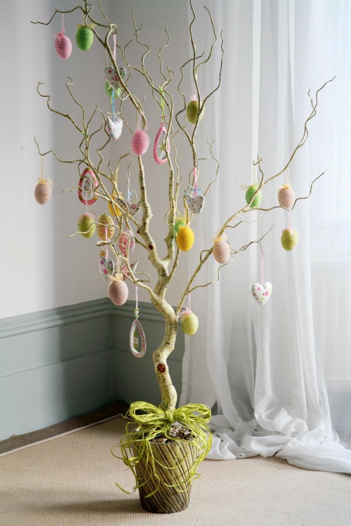 osterdeko pflanzentopf zweig dekorieren ostereier aufhängen