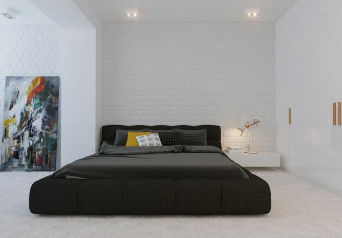 reduziertes wohnen doppelbett schlafzimmer weiße ziegelsteinwand