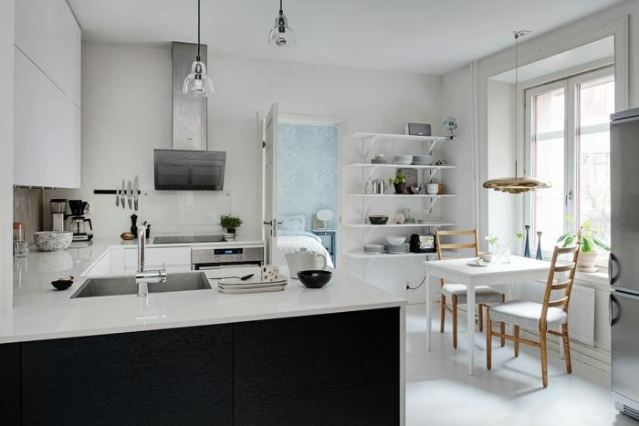 skandinavisch wohnen nordischer wohnstil offener wohnplan küche arbeitsfläche esstisch wandregale