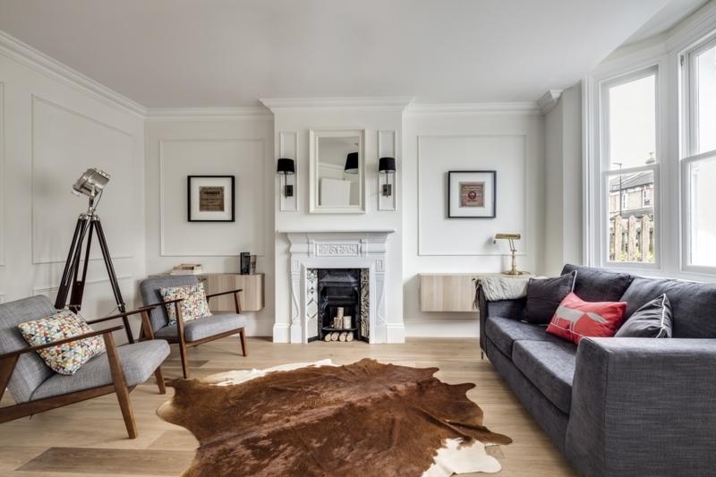 Skandinavisches Design Wohnzimmer Einrichtung Kuhteppich