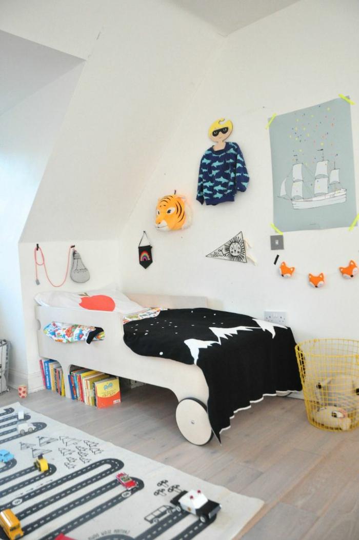 teppich kinderzimmer interaktiver kinderteppich weiße wände schwarze akzente