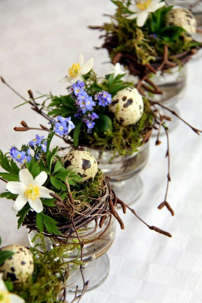 tischdeko ostern ostertischdekoration ideen gläser weidenzweige nest frühlingsblumen wachteleier