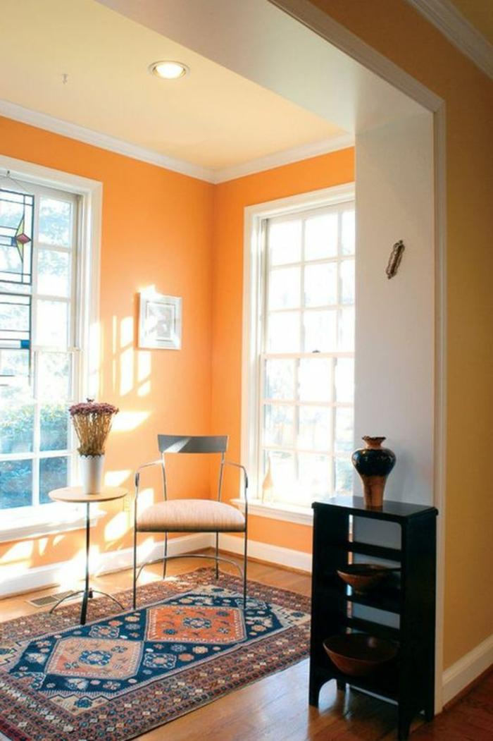 wandfarbe ideen orange wände teppichmuster hellgelbe zimmerdecke
