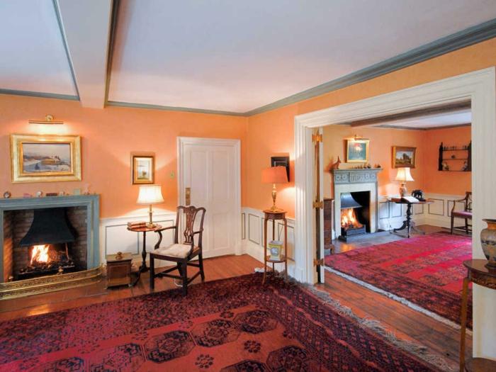 wandfarbe ideen orange wandfarbe teppich kamin gemütlich
