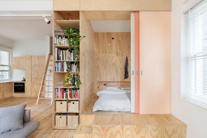 wohnraumgestaltung einzimmerwohnung schlafzimmer wohnbereich bücherreigale holzleiter